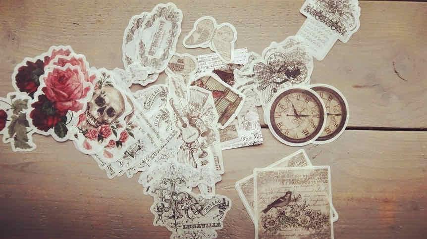 Hoe gebruik je vintage stickers in een journal